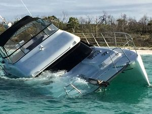 WATCH: Couple rescued from sinking $600,000 boat