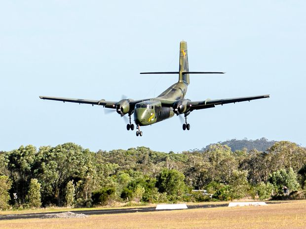 The DHC4-210 lands at the Evans Head airport to hundreds of spectators who cheered its arrival.
