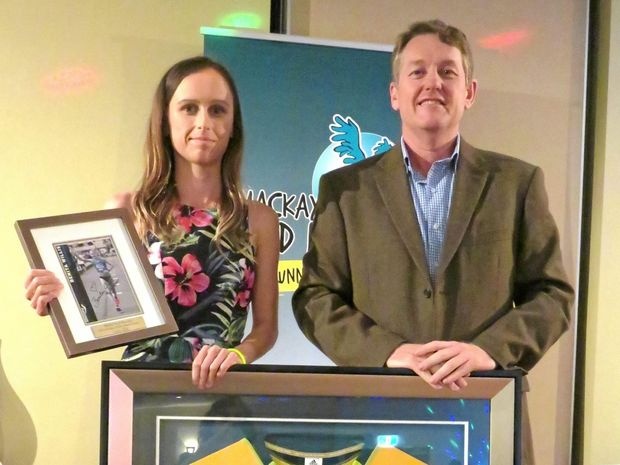 This year's Benita Willis 10km Handicap Champion, Ashlee Scott, accepts the prestigious award from club president Tim Magoffin. The award was one of many presented to deserving Mackay runners.