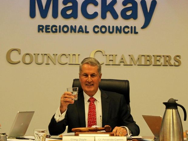 Mayor Greg Williamson raises a glass following Mackay Regional Council's decision to remove fluoride from the region's water.