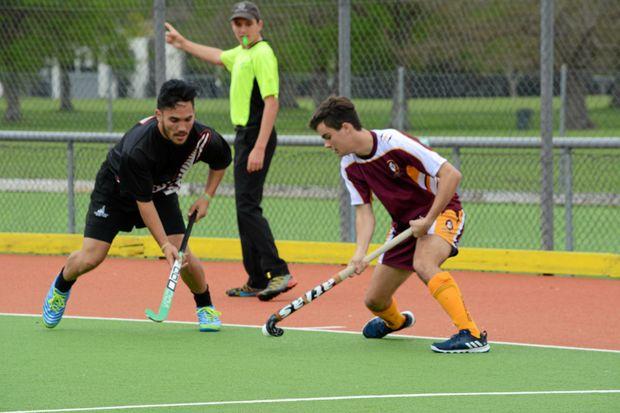 Matt Eastwell (right) playing for Queensland against a team from New Zealand during an unbeaten hockey tour.