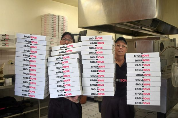 LOTTA PIZZA: Anthony and Robyn Rye were overrun with pizza orders during Monday's blackouts.