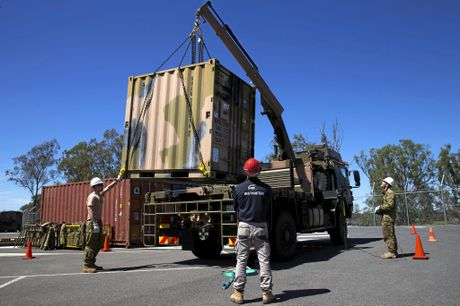 Australian Army soldiers are instructed in the use of the Hiab crane on a new Rheinmetall MAN truck as part of the first driver training course at RAAF Base Amberley in southern Queensland on 20 September 2016.