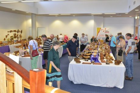 People check out the jacaranda woodwork exhibition yesterday.