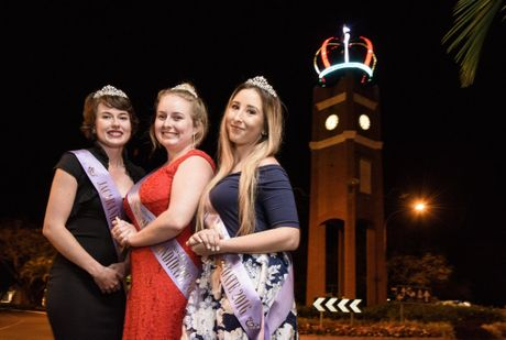 2016 Jacaranda candidates Sharni Wren, Heidi Madsen and Shannon Carter in front of the lit up Jacaranda Crown that was placed on top of the clocktower in preparation for the festival.
