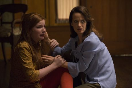 Annalise Basso and Elizabeth Reaser in a scene from the movie Ouija: Origin of Evil.
