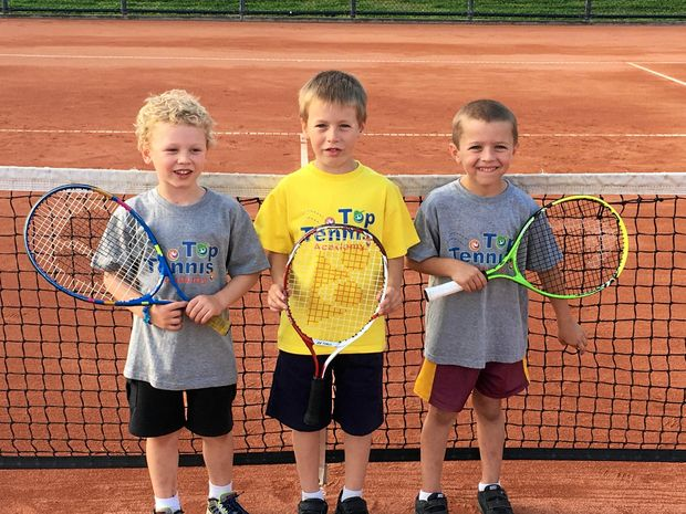 SUPER STARS: Junior Hot Shots players Tom Berry, Will Penn, Lennox Picker Hot are enjoying their time on the court, while (below) Luca O'Connor and Claire Gould celebrate winning the girls 13s-and-under doubles final at the Junior Development Series tournament on the weekend.