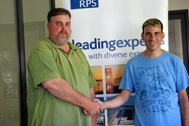 HELPING HAND: RPS surveyor Brett Campbell and Jim Tzatzalos.