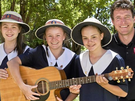 STANDING OUT FROM THE CROWD: The Glennie School students (from left) Charlotte Lamshed, Kate Bellars and Penny Lamshed with musician Josh Arnold released their song for the Walk for Toowoomba YoutTube series yesterday.