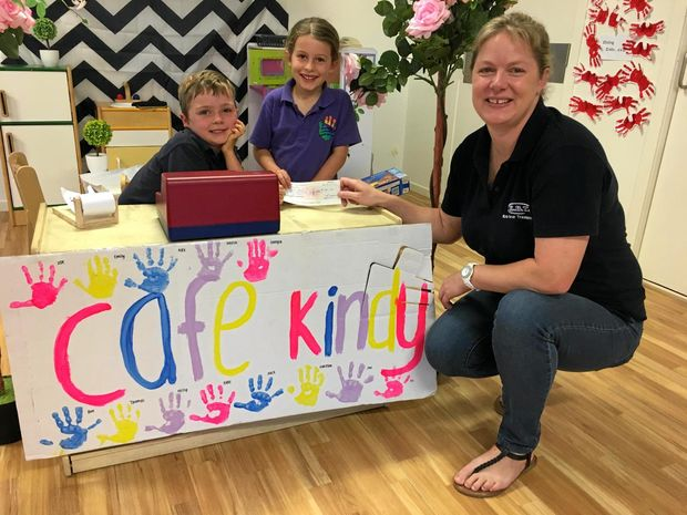YOUNG HELPERS: Chinchilla Community Kindergarten students, Oliver Hendriksen and Eden Collett, present Nicki Stansbie from Drought Angels with a cheque for $120.50; the proceeds from their Kindy Cafe experience.