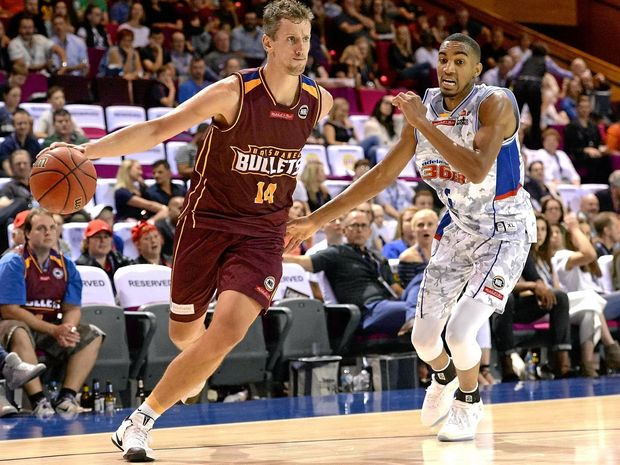 Daniel Kickert of the Bullets drives to the basket during the round-two NBL match between Brisbane and the Adelaide 36ers.