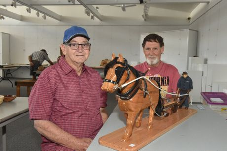 WOODIES EXPO: Kevin Dowd and Ken Hooper with Kevin's entry into the competition - a carved horse and plough that took him over a year to make.