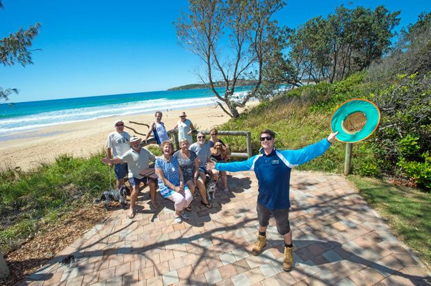 Lakeside Caravan park, park staffer Ryhs Tolhurst with a crew of happy campers at the park's beach front bar be cue area Woolgoolga. 18 October 2016