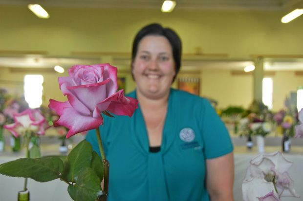 FULL BLOOM: Laura Babington with her grand champion rose.