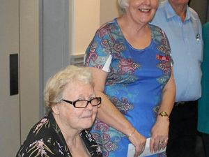TURNING THE PAGE: The Book launch of Its A Lottery is Writers Group convenor, Judy Whitworth busy signing with two of the 16 authors, Joan Brown and Rodger Williamson at the Frenchville Sports club earlier this month.
