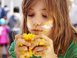 MESSTIVAL: A child enjoys a mango at a mango 'messtival'.