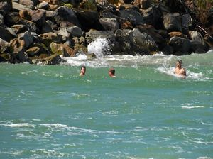 Swimmers at the mouth of the Evans River.