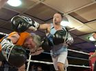 Fundraising bout participants John Geiger (left) and Nick Barker battle it out at Smithy and TGW Bring The Big Fights 14 at Rumours International, Saturday, October 22, 2016.