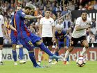 A Lionel Messi double, including a dramatic injury-time penalty, has helped Barcelona to a 3-2 win over Valencia.