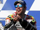 Cal Crutchlow of Britain for LCR Honda sprays champagne as he celebrates his win in the 2016 Australian MotoGP at Phillip Island.