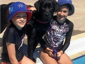CLEVER CANINE: Smart Pup Tyson with two Sunshine Beach students.