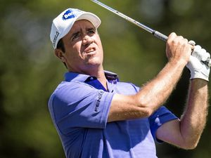 Scott Hend of Australia watches a tee shot.