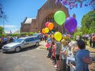 Balloons are released as the hearse pulls away from the funeral of Jodie Spears at the Christ Church Cathedral.