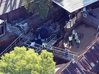 Queensland Emergency service personnel are seen at amusement theme park Dreamworld on the Gold Coast, Queensland, Tuesday, Oct. 25, 2016. Four people have died after an accident on a ride at Dreamworld. The victims became trapped on a conveyor belt at the theme park after a raft they were in flipped on the Thunder River Rapids ride on Tuesday afternoon. (AAP Image/Dan Peled) NO ARCHIVING