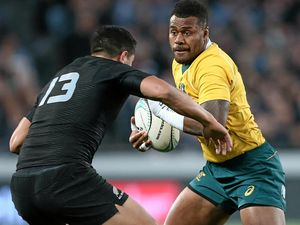 Samu Kerevi of Australia is challenged by Anton Lienert-Brown of New Zealand during their Bledisloe Cup match at Eden Park on Saturday.