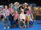 RODEO ROYALTY: Former women's World Rodeo Champion visited West State School yesterday, from left to right in their rodeo gear are Mark Skinner, Joey Beveridge, Erina Skinner, Jason Skinner, Daniel Walters, Hayley Leeson, Tasmin Walters and Jack Beveridge.