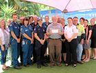 GENEROUS LOCALS: Emerald Emergency Services present cheque to Emerald Neighbourhood Centre.