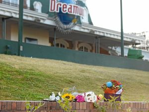 Flowers are placed outside of Dreamwolrd theme park, remebering the four people who died in an amusement ride accident.