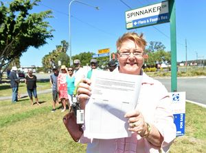 Joy Leishman and her fellow Spinnaker residents are petitioning to have traffic lights installed at the intersection of Spinnaker Drive and Bribie Island Road.