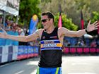 ONE OF THE BEST: Craig Mottram crosses the finish line in the Legends Triathlon at Noosa.