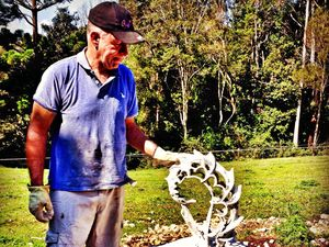 Northern Rivers artist Rudy Stavar working on one of his creations.