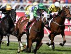 Michelle Payne (centre) rides the Darren Weir-trained Prince of Penzance to victory in the Melbourne Cup at Flemington Racecourse in Melbourne in 2015.