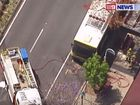A BUS is on fire and several passengers injured after a serious crash this morning.