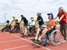 STARTERS ORDERS: Athletes line up for the 50m wheelchair dash at the Bundaberg Athletics track for the Bundability Games.