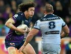 Kevin Proctor of the Storm (left) tries to evade Matt Scott of the Cowboys.