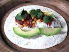 This colourful and healthy blend of vegetables makes a delicious meal; wrap in a tortilla to serve.