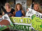 TWIN WEST: Lorraine Taylor, Kathryn Hyman and Tracey Hanna with signs made for today's protest rally against planning amendment at Twin Waters West.