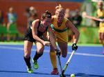 THE BEST: Hockeyroo Jodie Kenny, right, with Kelsey Smith of New Zealand.
