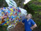 Grace M admiring Empire Vale Public School's art sculpture made from reused recess packaging.