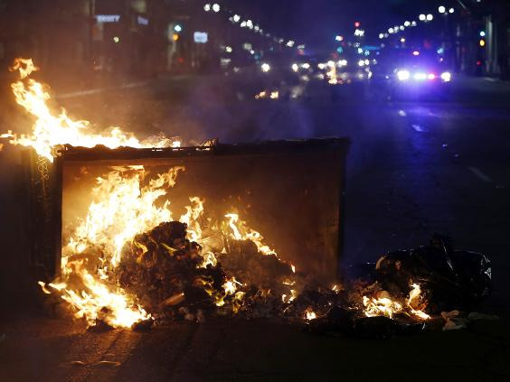 Anger over Trump explodes; protesters set fires, smash glass