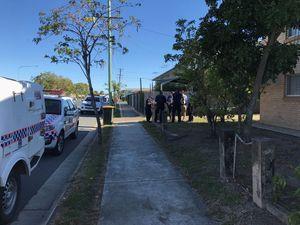 Police leave the scene