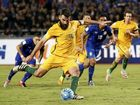 Australia's Mile Jedinak scores the equaliser from the penalty spot against Thailand in Bangkok.