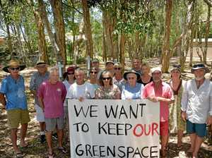 Crosses mark battleground in fight to save green space