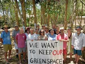 Protesting against plans to move the Coolum Community Centre to a suburban block of land are (back, from left) Cindy Jackson, Linda Jackson, Helena Lloyd, Mark Sykes, (middle, from left) Rob Hanson, Prue McGowan, Jan Johnstone, Jennifer Barnett, Fiona Sykes, Linda McKeachie, (front, from left) Darryl McGowan, Peter Williamson, Greg Onions, Dorothy Hookway, Truda Landreth, Rod Coper and Jim Moore.