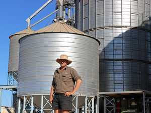 AN HONOUR TO WIN: Dane Lund on the family property Wondabah with the silos where the magic happens.