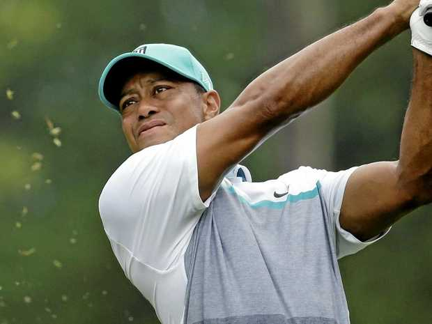 Tiger gets back to golf with questions about head, not body